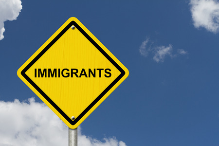 immigrants: Immigrants Warning Sign, Yellow warning road sign with word Immigrants with sky background