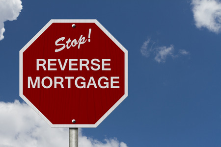 mortgage: Stop Reverse Mortgage Road Sign, Stop sign with words Reverse Mortgage with sky background
