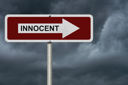 innocent: The way to to being Innocent, Red and white street sign with word Innocent with stormy sky background