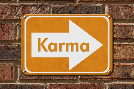 brick building: Karma Sign,  A orange sign with the words Karma on a brick wall
