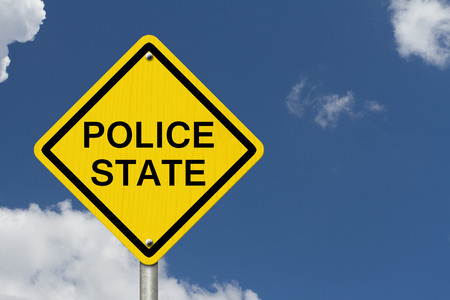 police state: Police State Caution Road Sign, Caution sign with word Police State with sky background
