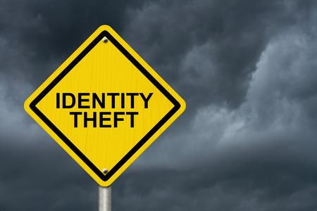 identity theft: Identity Theft Warning Sign, Yellow warning road sign with word Identity Theft with stormy sky background