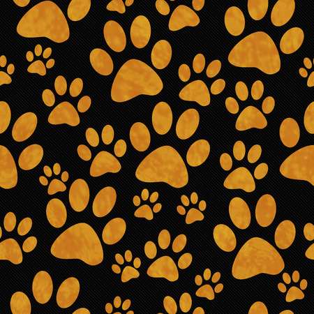 animal pattern: Orange and Black Dog Paw Prints Tile Pattern Repeat Background that is seamless and repeats