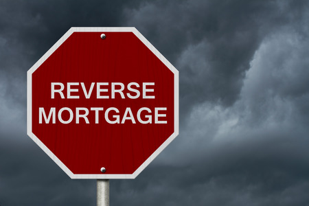reverse: Stop Reverse Mortgage Road Sign, Stop sign with words Reverse Mortgage with stormy sky background