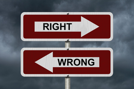 street signs: Right versus Wrong, Red and white street signs with words Right and Wrong with stormy sky background