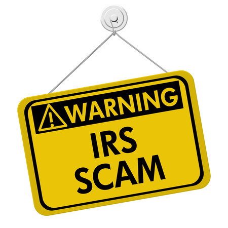 IRS Scam Warning Sign,  A yellow sign with the words IRS Scam isolated on a white background Standard-Bild