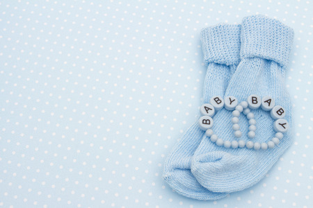 baby blue: Baby Blue Background with Baby Socks and Bracelets with copy space for your message Stock Photo