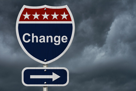 alter: Change Sign, A red, white and blue highway sign with word Change and an arrow sign with stormy sky background Stock Photo