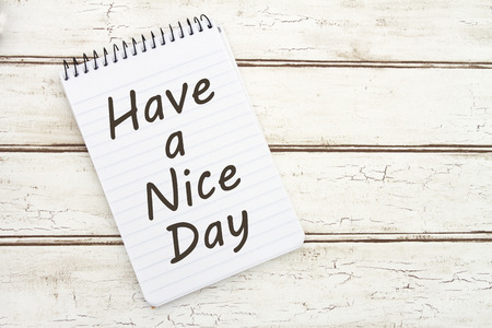 nice day: Have a Nice Day, A spiral Notepad that has the words Have a Nice Day over a distressed wood background Stock Photo
