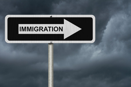 immigrate: The way to Immigration, Black and white street sign with word Immigration with stormy sky background