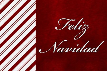 feliz navidad: A Feliz Navidad card, A Candy Cane Stripes with words Feliz Navidad over red plush background