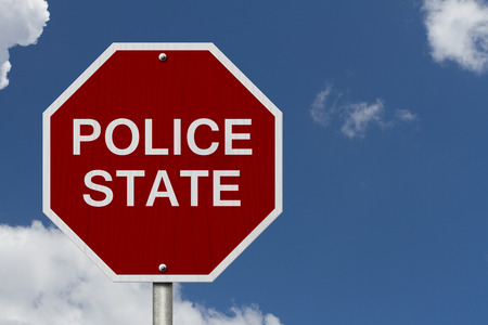 police state: Stop Police State Road Sign, Stop sign with words Police State with sky background Stock Photo