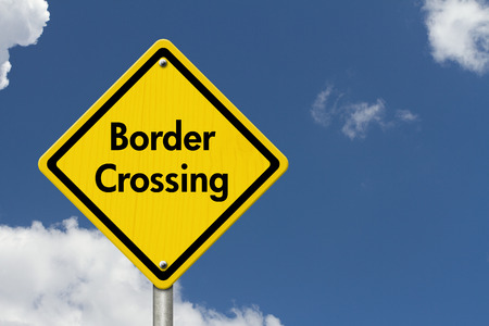illegal immigrant: Border Crossing Road Sign, Yellow Caution sign with word Border Crossing with sky background