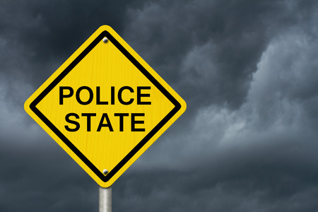 police state: Police State Caution Road Sign, Caution sign with word Police State with stormy sky background