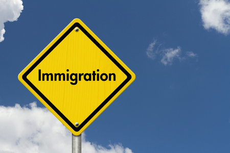 illegal immigrant: Immigration Road Sign, Yellow Caution sign with word Immigration with sky background