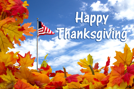 Happy Thanksgiving, Autumn Leaves, Pumpkins and USA flag with sky background with text Happy Thanksgiving Stock Photo