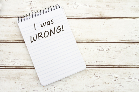 wrong: I was Wrong, A spiral Notepad that has the words I was wrong over a distressed wood background