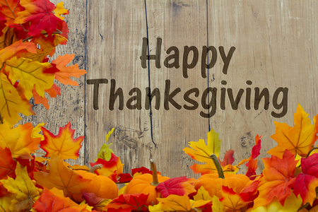 happy holidays: Happy Thanksgiving, Autumn Leaves and Pumpkins with grunge wood background with text Happy Thanksgiving Stock Photo