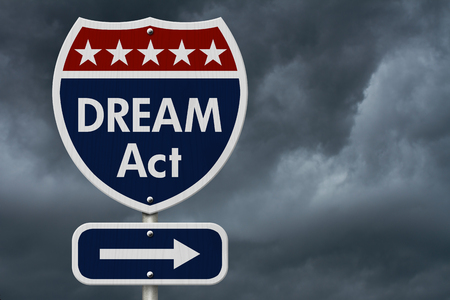 unlawful act: American DREAM Act Highway Road Sign, Red, White and Blue American Highway Sign with words DREAM Act with stormy sky background Stock Photo