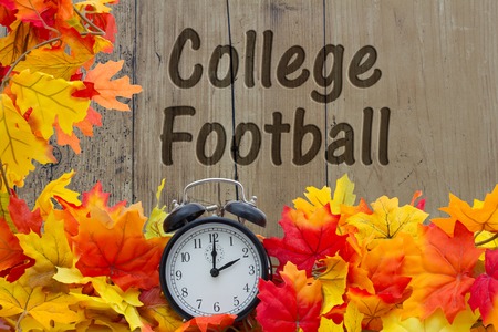 college football: Time for College Football Season, Autumn Leaves and Alarm Clock with grunge wood with text Collage Football