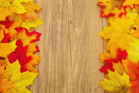 space wood: Autumn Leaves on Weathered Grunge Wood with space for message