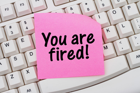 you are fired: Computer Keyboard with a pink blank sticky note with text You are fired