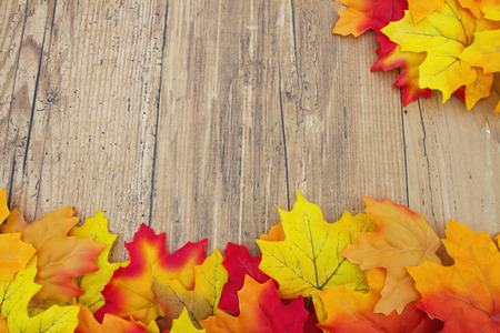 thanksgiving background: Autumn Leaves on Weathered Grunge Wood with space for message