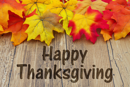 Happy Thanksgiving, Autumn Leaves on Weathered Grunge Wood with text Happy Thanksgiving