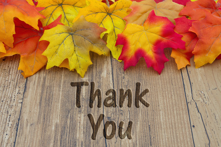 grateful: Thank You, Autumn Leaves on a Weathered Wood Background with text Thank You