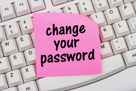 Change your password, Computer Keyboard with a pink blank sticky note with text Change your password