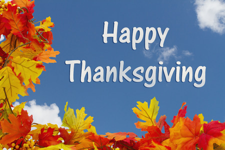 happy thanksgiving: Happy Thanksgiving, Autumn Leaves with sky background with text Happy Thanksgiving Stock Photo