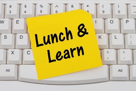 computers online: Lunch and Learn, Computer Keyboard with a yellow blank sticky note with text Lunch and Learn