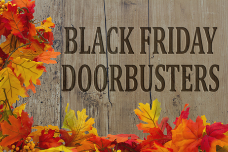 Black Friday Shopping Doorbusters, Autumn Leaves with grunge wood with text Black Friday Doorbusters