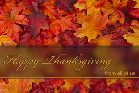 Happy Thanksgiving Greeting, Fall Leaves Background and text Happy Thanksgiving from all of us Stock Photo - 48801203
