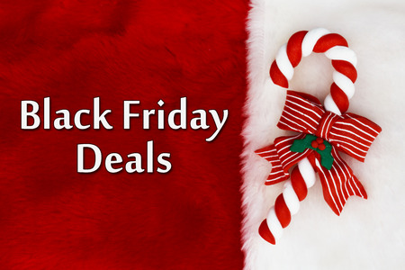 black: Black Friday Deals, Red Plush background and a Candy Cane with text Black Friday Deals