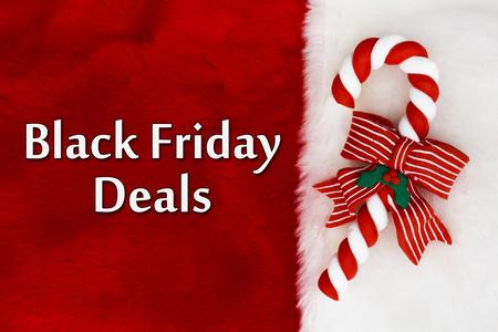 fond de texte: Noir Offres vendredi, peluche rouge arrière-plan et un Cane Candy avec texte offres Black Friday Banque d'images