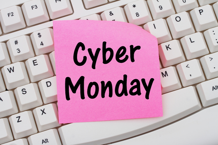 computers online: Online shopping on Cyber Monday, Computer Keyboard with a pink blank sticky note with text Cyber Monday Stock Photo
