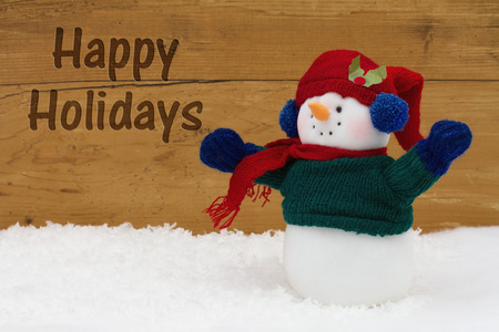 snowman wood: Happy Holidays Message, A Snowman on snow with a weathered wood background and text Happy Holidays