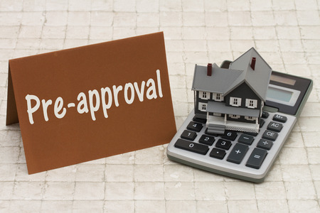 mortgage rates: Home Mortgage Pre-approval, A gray house, brown card and calculator on stone background with text  Pre-approval