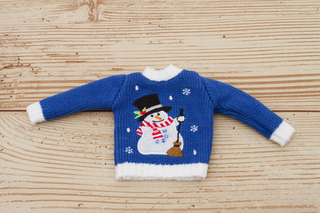 snowman wood: Blue and White Snowman Christmas Sweater on a Weather Wood Background