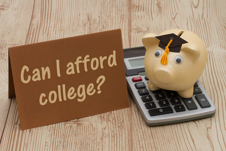 afford: Can I afford college, A golden with grad cap piggy bank, card and calculator on a wood background with text Can I afford College
