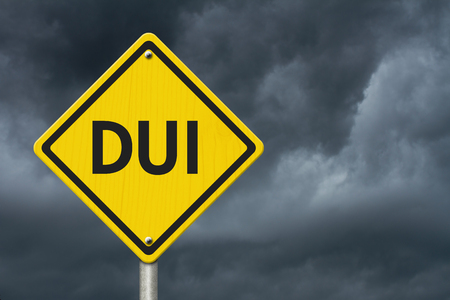 dui: Yellow Warning DUI Highway Road Sign, Red, Yellow Warning Highway Sign with words DUI with stormy sky background