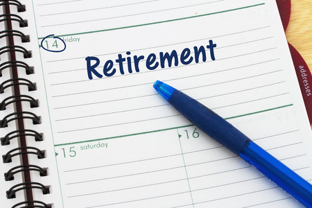 Planning your retirement, a day planner with blue pen with text Retirement