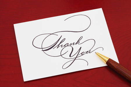 Thank You Card, White Greeting card with text Thank You on a red wood background