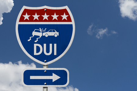 dui: Red, White and Blue American Highway Sign with words DUI with sky background