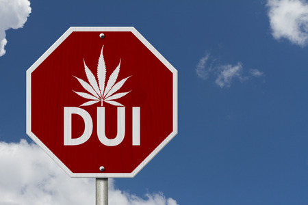 Red and White Stop Sign with words DUI and marijuana leaf with sky background