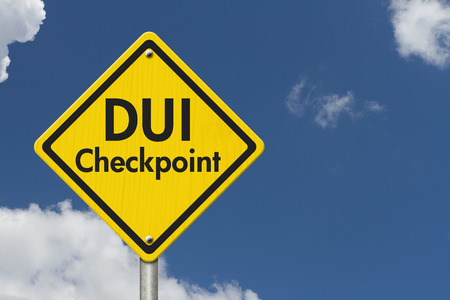 dui: Yellow Warning Highway Sign with words DUI Checkpoint with sky background Stock Photo
