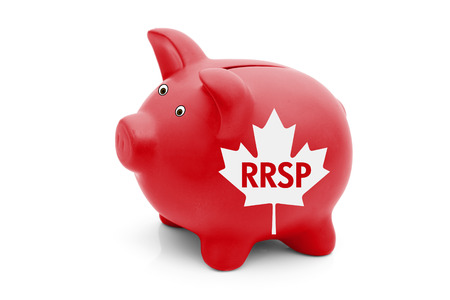 canadian maple leaf: A red piggy bank with a white Canadian maple leaf flag and text RRSP isolated on white