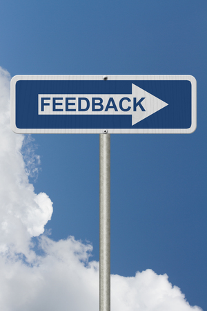 A Blue Road Sign with text Feedback with sky background Stock Photo