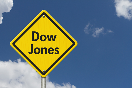 dow: Yellow Warning Highway Sign with words Dow Jones with sky background